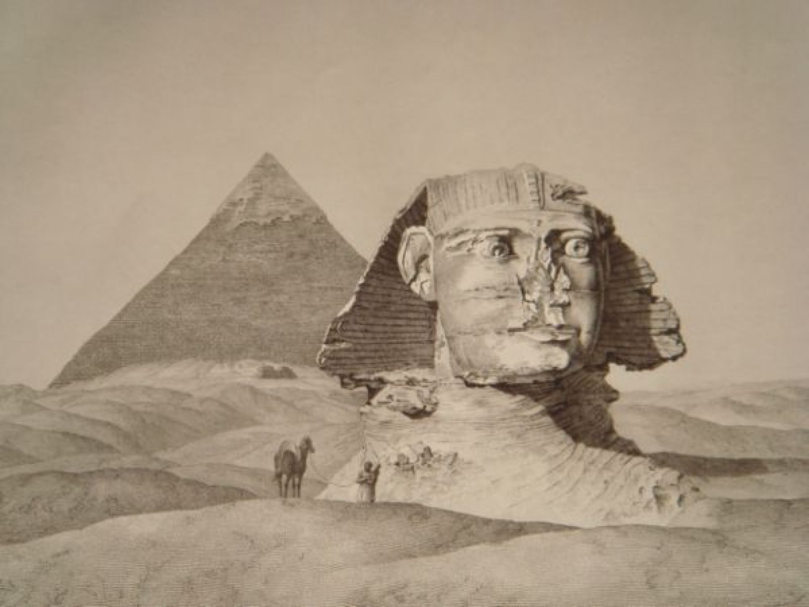 Sphinx with pyramids in the background, a single man leading a camel in the foreground